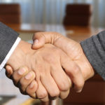 Handshake on successful financing